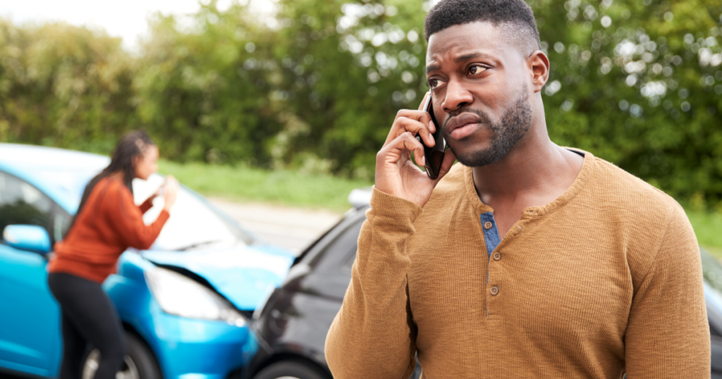 man on phone after a car accident