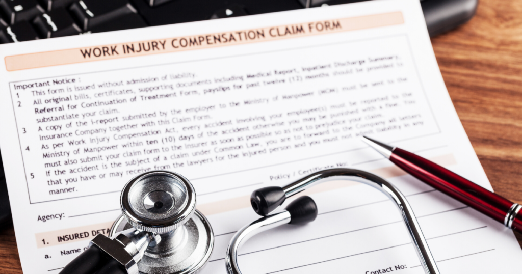 work injury compensation claim form with doctor's stethoscope on it
